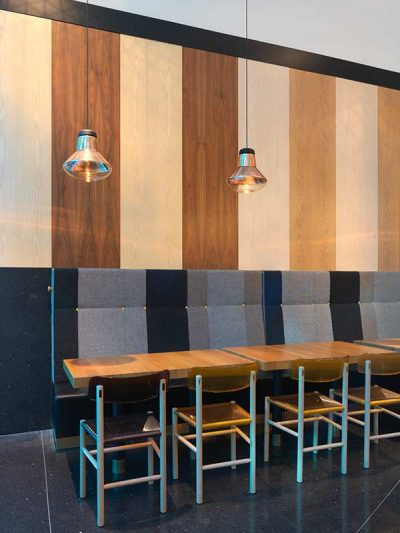 Coffe shop interior with wooden wall panels