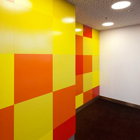 Decorative wall panelling with painted surface