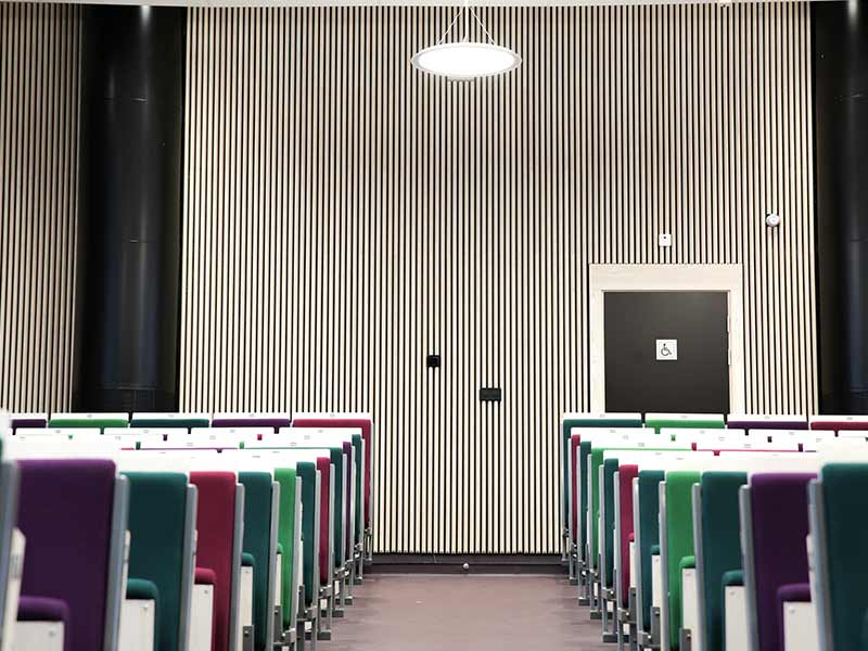 School auditorium with wooden rib cladding