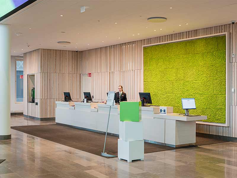 Reception cladded with wooden panels