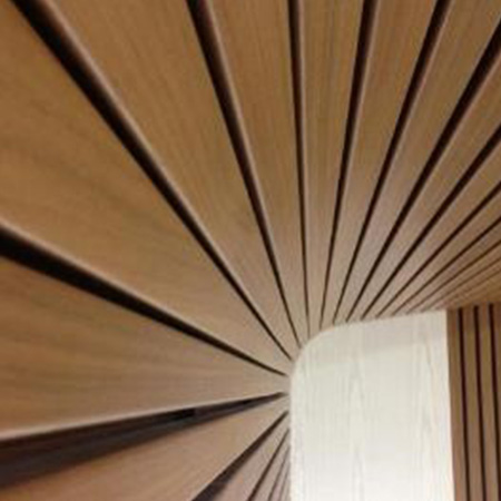 Curved wooden rib installation for wall and ceiling panelling