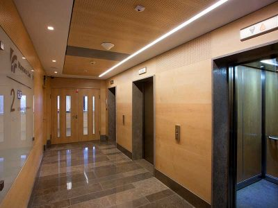 Office interior cladded with wood veneered panels