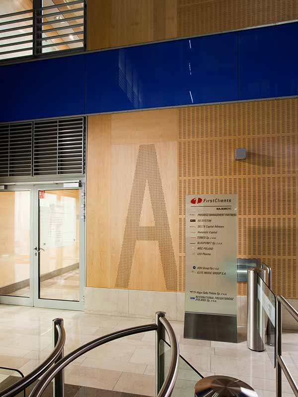 Office interior entrance with acoustic perforated panels