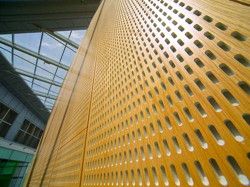 Slot perforated wooden panels at Southmead Hospital