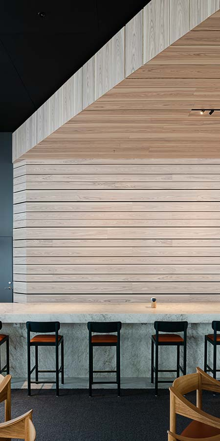 Bespoke wooden interior cladded with plank panels