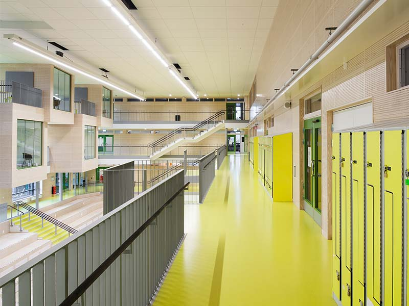 Acoustic wall panels in school atrium