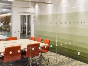 Meeting room with gradient printed ash veneer