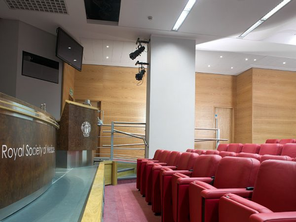 lecture hall acoustic design with perforated wooden wall panels