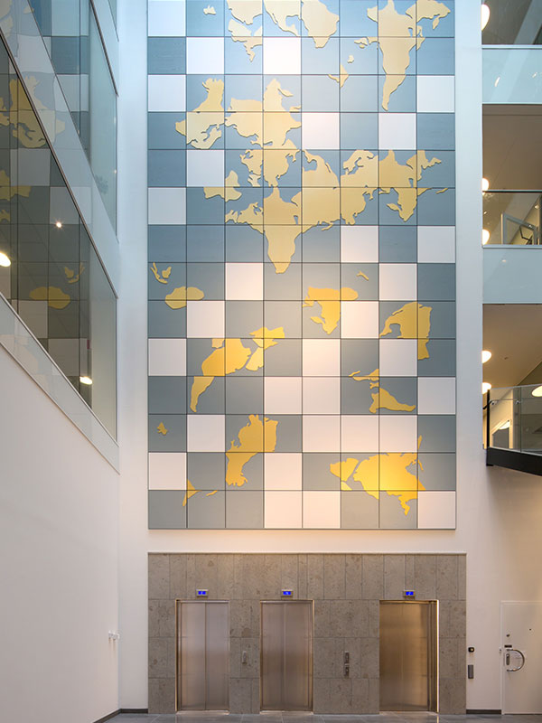 Atrium with wall paneling and artwork
