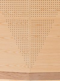 diagonal perforated pattern on wood panels