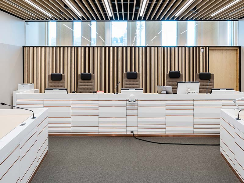 Courtroom cladded with timber slat modules in ash