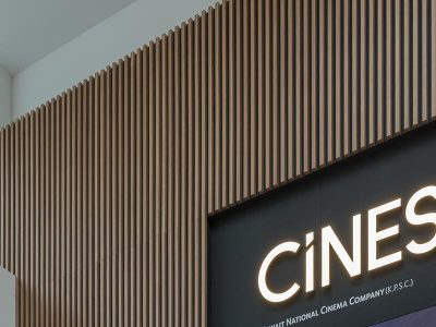 Walnut slatted panels installed at the entrance of Al-kout Cinema