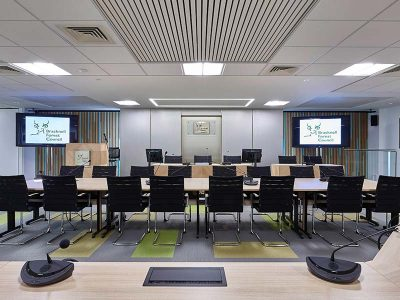 Meeting room cladded with fire retardant timber acoustic panels