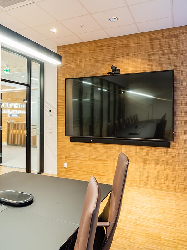 Oak veneered acoustic panels are cladding conference room