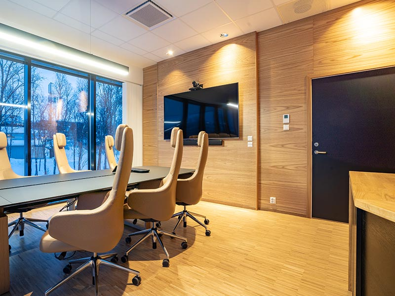 Acoustic perforated panels cladding meeting room