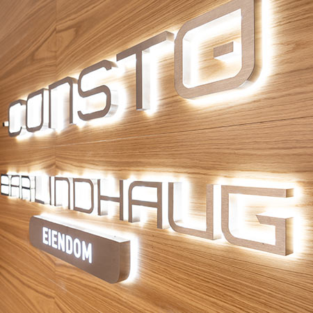 Wooden panels mounted on wall with backlit logo