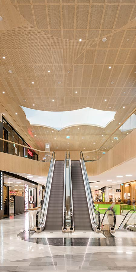 Acoustic wood panels for mall claddings