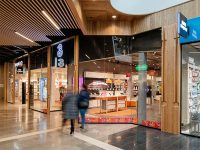 Retail interior with ceiling timber panels