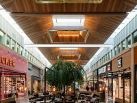 Massiv lampshades in wood for shopping center interior