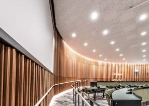 Curved wall installation of slatted timber panels