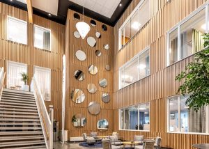 Refurbished office with atrium cladded with timber panels in oak veneer