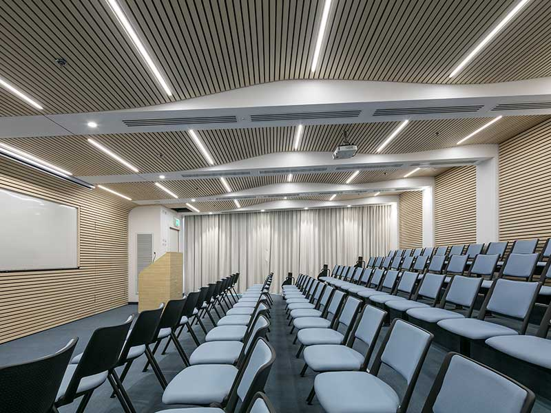Timber panels in auditorium cladded on walls and ceiling