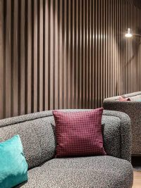 Hotel interior with slatted timber panels installed on the walls