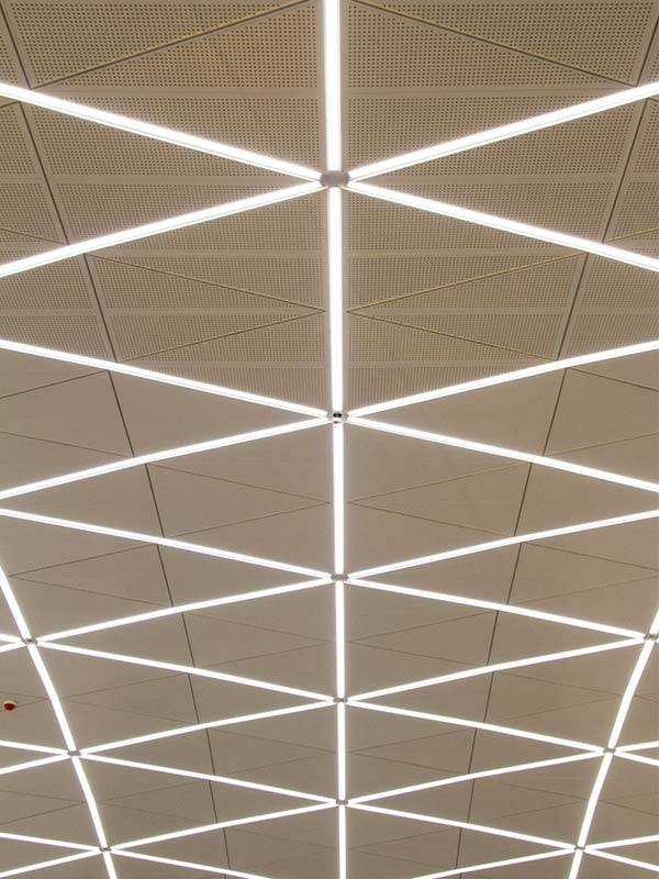Acoustic perforated ceiling panels with integrated led-lighting
