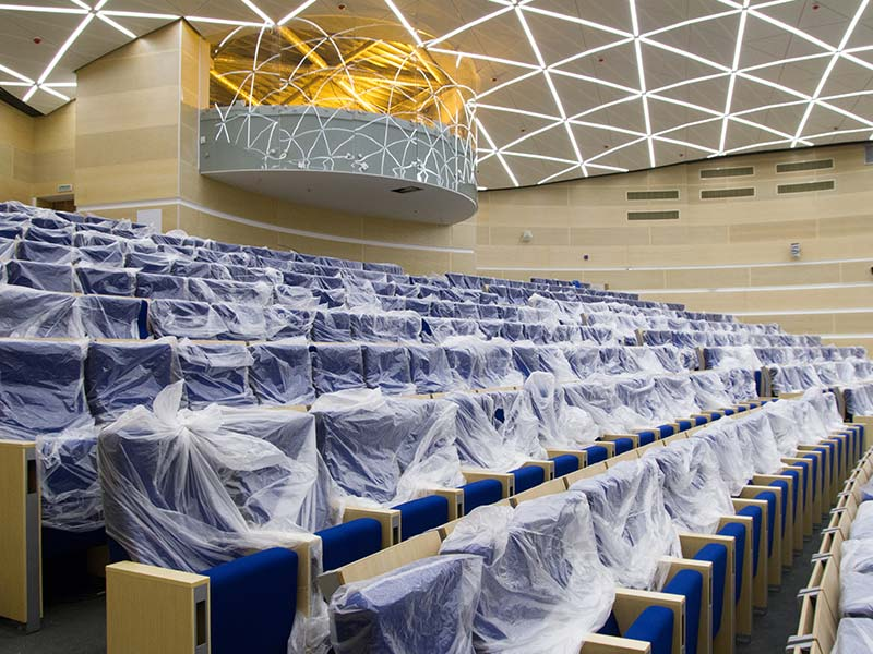 Auditorium cladded with acoustic wood panels