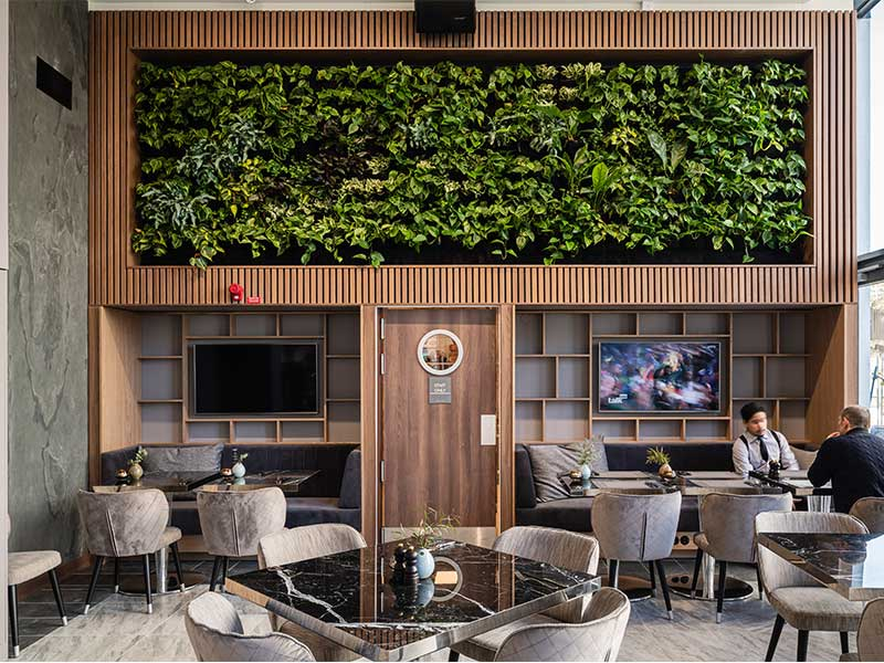 Green wall framed by Gustafs Linear Rib at AC By Marriott in Stockholm