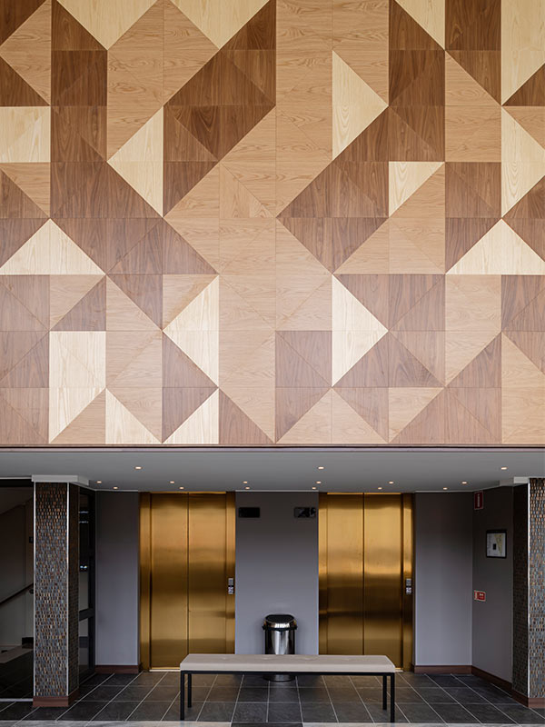 Wood panels in triangular shapes making up a beautiful wall at AC By Marriott in Stockholm