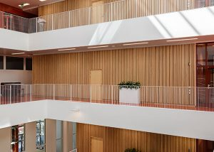 Atrium cladded with slatted wood claddings