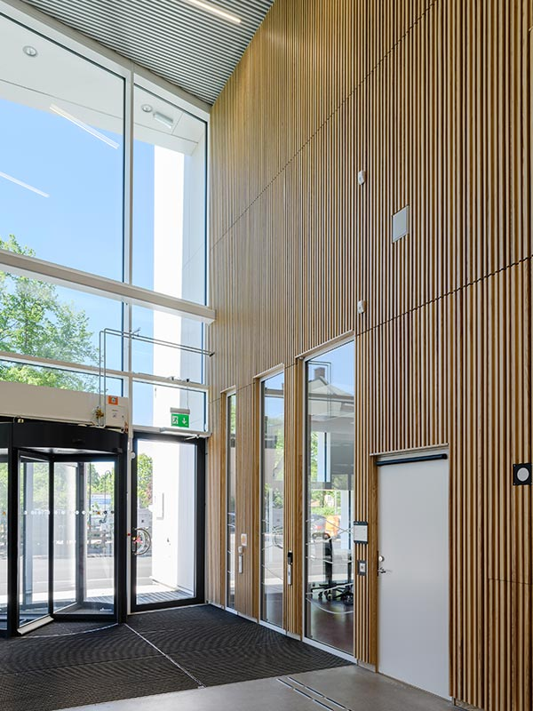 Entrance cladded with slatted wood panels