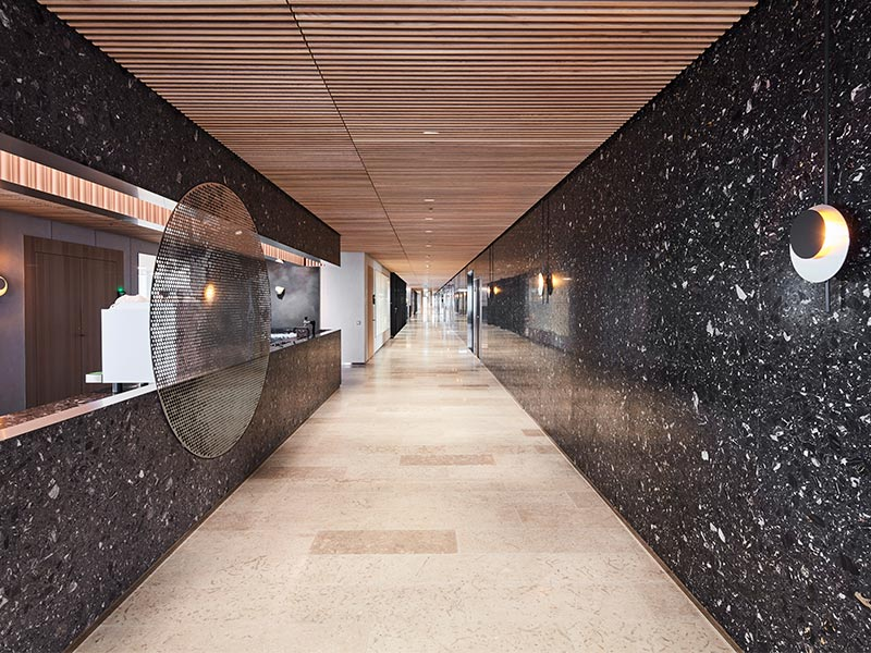 Office corridor with slatted timber panels