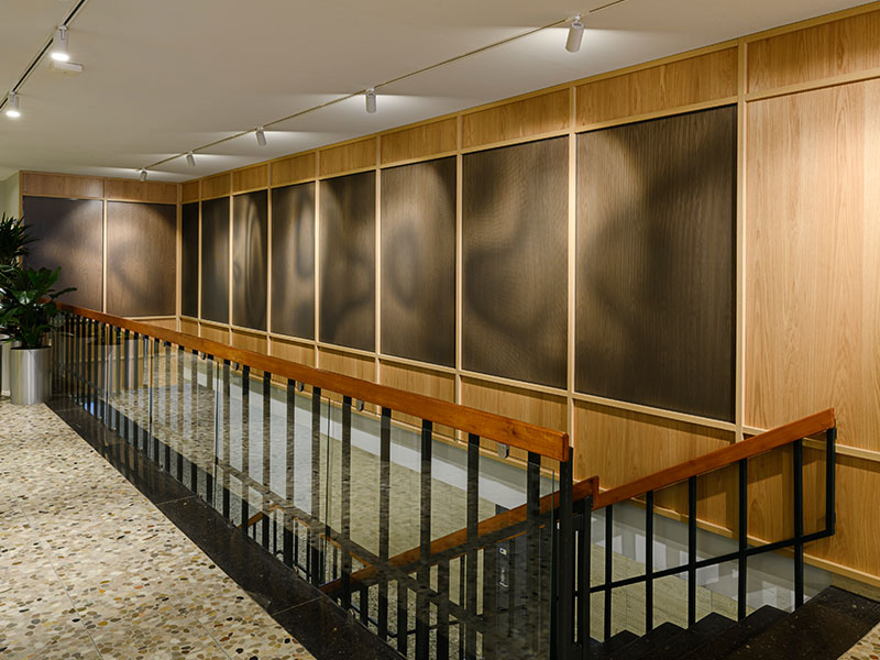 Wooden-clad wall with Gustafs acoustic panels