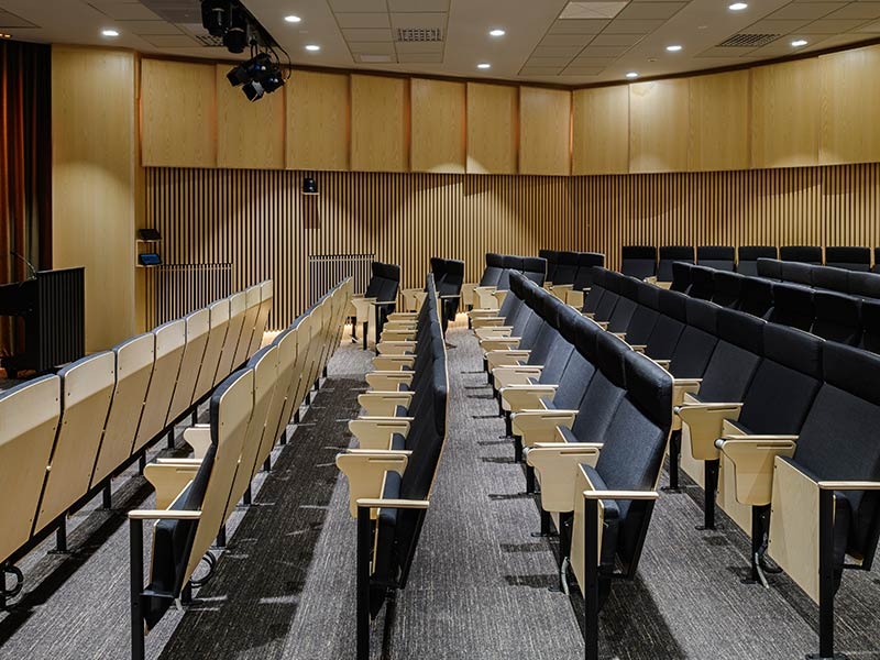 Wooden wall claddings in refurbished auditorium