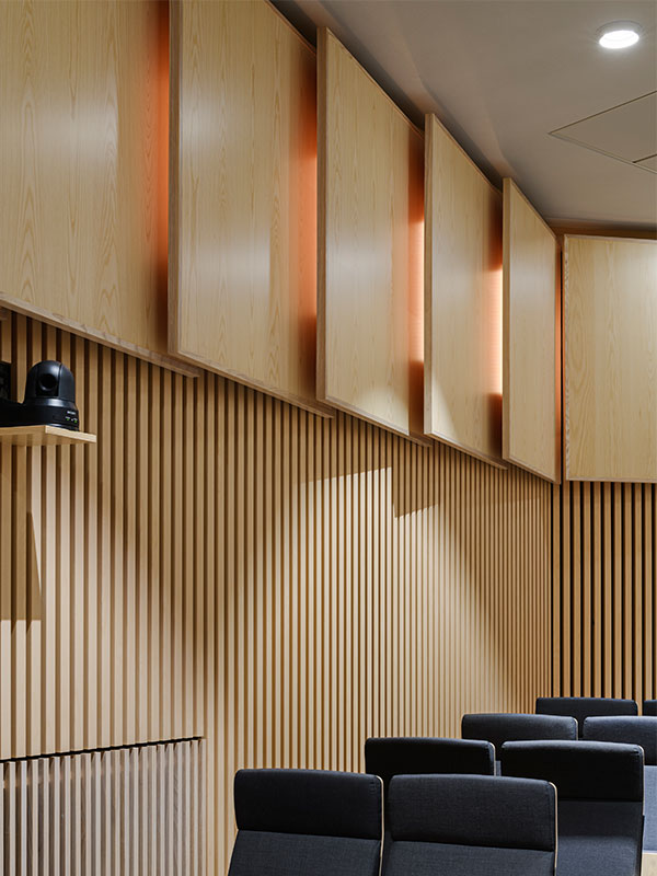 Wall panelling with timber panels and acoustic wood panels in refurbished plenary hall