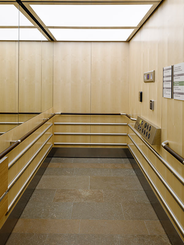 Elevator clad with wood panels in birch