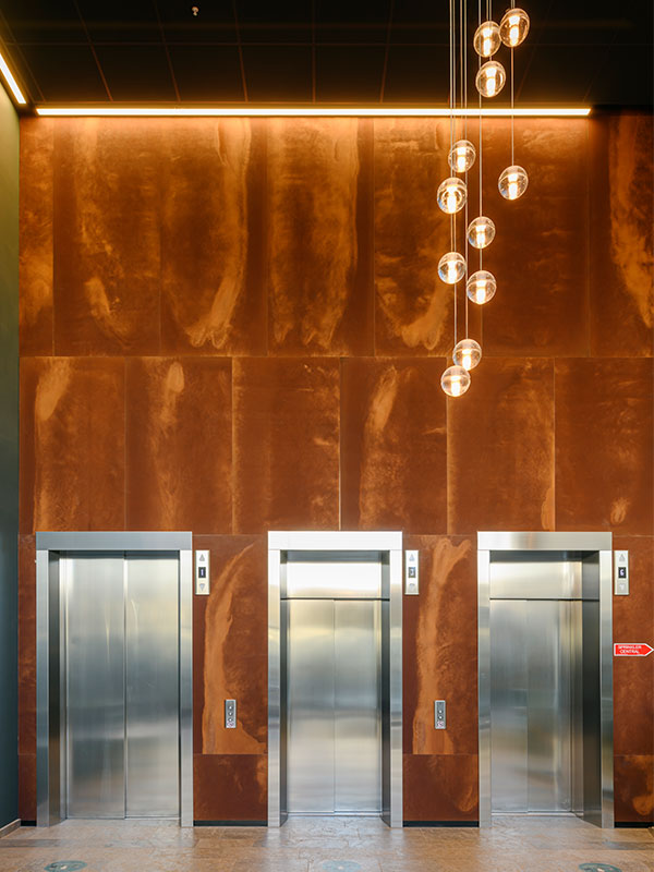 Curanten entrance with corten laminate produced panels