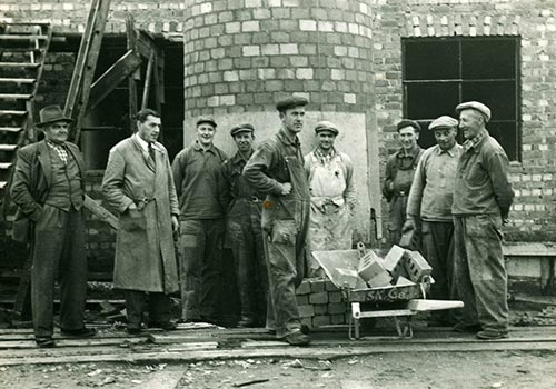 Old photo of workers outside the Gustafs' factory