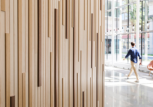 Vertical wood panels can add texture and character in a way that a smooth wall surface does not.