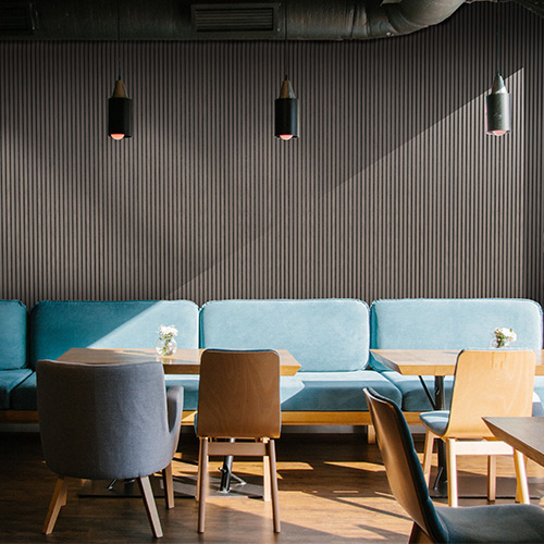 Wall installation of acoustic wood panels Gustafs Lamellow in café